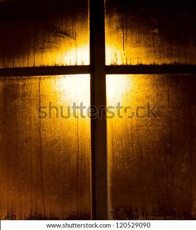 illuminated wooden window frame ...