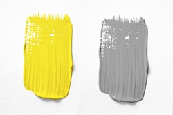 Illuminating and Ultimate gray Pantone color of the year 2021 oil paint stroke on white background