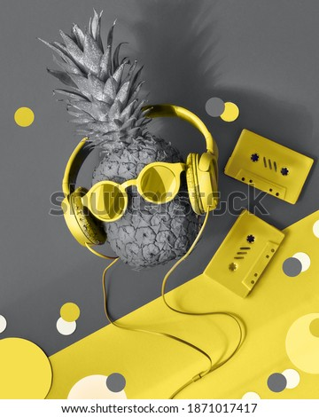 Illuminating Yellow and Ultimate Gray, colors of the year 2021. 90s nostalgy, hipster pineapple character in trendy sunglasses and earphones listens to the music. Photo stock ©