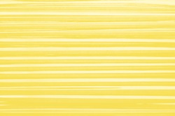 Illuminating yellow Cling film folds texture, plastic, vinyl background. Striped overlay for mockup. Abstract, art design, layout.