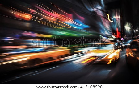 Illumination and night lights of big city. Intentional motion blur