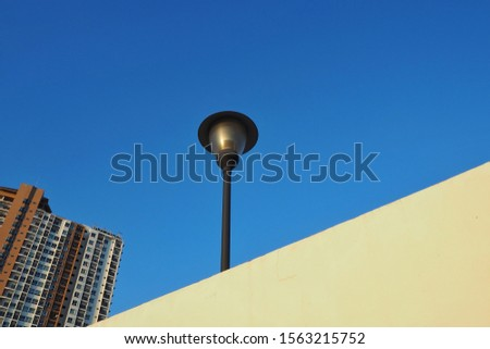 Illumination in outdoor parks with blue background.Modern street lamp against the blue sky without clouds #1563215752