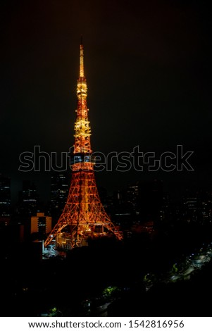 Illumination of Tokyo Tower in Japan with many  skyscraper. Orange illumination for Tokyo Tower. #1542816956