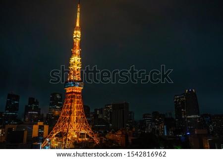 Illumination of Tokyo Tower in Japan with many  skyscraper. Orange illumination for Tokyo Tower. #1542816962
