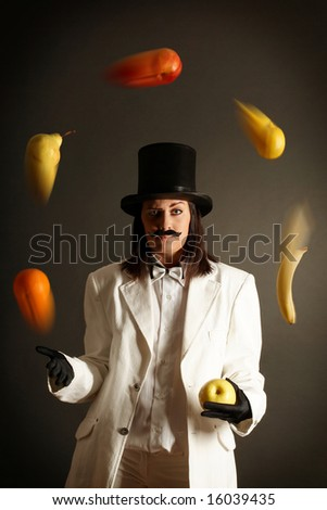 illusionist juggling with different fruits