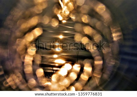 illustrated blurry sun reflection on wavy water surface on blurry abstract blurry background