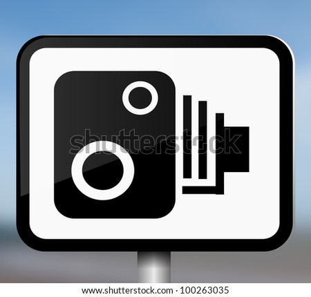 Illustration depicting a single black and white speed camera warning sign blurred blue background.