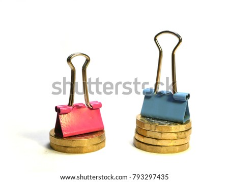 Illustration of gender pay gap using blue and pink bulldog clips with pound coins, blue clip on stack of four pound coins, pink clip on stack of two pound coins