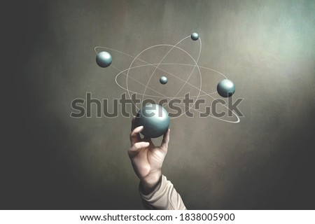 illustration of hand holding sphere that represents planets activities, science surreal concept
