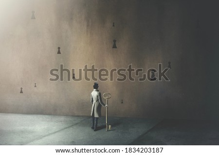 illustration on man holding big key in front of many different keyholes, surreal concept Foto stock ©