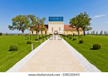 ILOK, CROATIA - MAY 5: Castle Principovac, restored in 2009, settled on hills above Ilok, Croatia on May 5, 2012. Castle is surrounded by vineyards with premium wines, such as Riesling and Traminer.