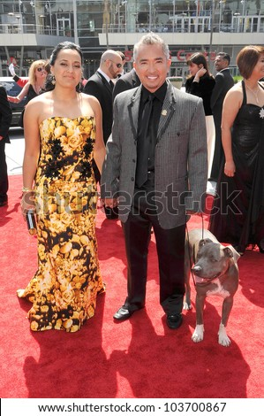 Ilusion Millan and Cesar Millan at the 61st Annual Primetime Creative Arts Emmy Awards. Nokia Theatre, Los Angeles, CA. 09-12-09
