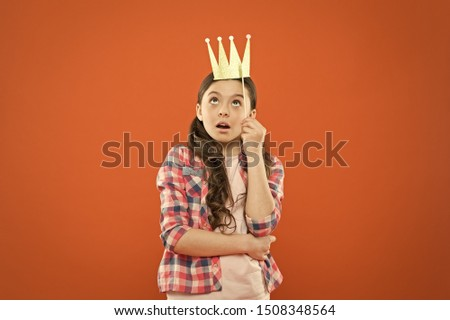 Im a big boss here. Little big boss on orange background. Cute girl boss wearing prop crown. Small happy child with big surprise on her face. Adorable boss lady dreaming big ambitious dreams.