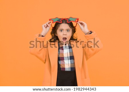 Im surprised. Small schoolgirl keep mouth open with surprise. Little girl look surprised yellow background. Surprised child in fashion school style. Being surprised. Surprise school party celebration