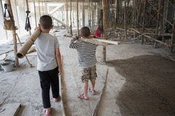 Image blur, Poor children working at construction site against children labour,  World Day Against Child Labour  and trafficking concept.
