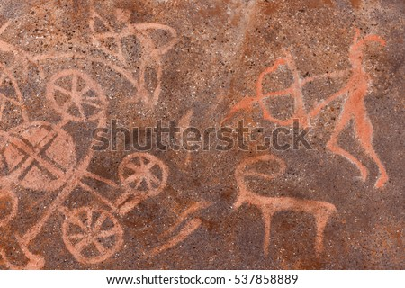 Image drawing of ancient man in ocher on the cave wall, rock. prehistoric man hunted with bow and arrow for game animals. The Stone Age, Ice Age, native, Neanderthal.