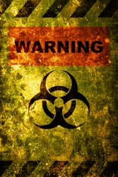 Image for caution. Warning Danger Biohazard sign word text as stencil with yellow and black   over rusty metal plate Rusted metal texture