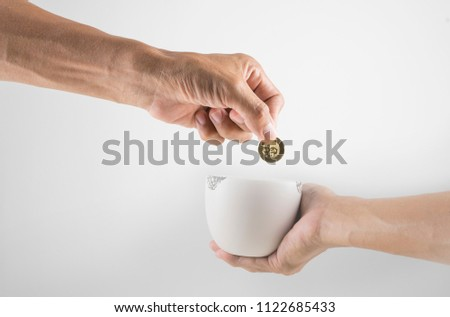 Image for cropped hand in donation
