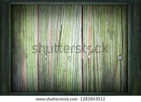 Image for Saint Patrick's Day on March 17th. A green wooden frame surrounds a green wooden background. Vignette added. Copy space.
