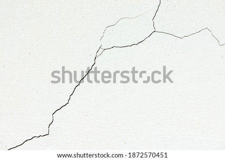 Image for use as a background, diagonally cracked white wall, which is still a small line, not very large. Which the renovation is still easy