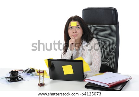 Image forgetful business woman with laptop in a bright office. Isolated on white background