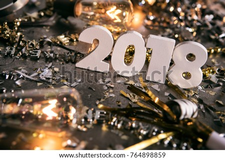 Image from a series celebrating New Year\'s Eve, some with 2018 numerals.  Lots of confetti, champagne, etc. Good for backgrounds of ads.