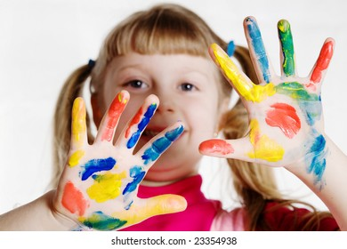 Stock photo: an image of a funny girl with her hands in paint