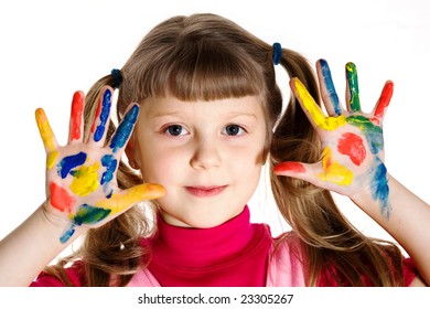 Stock photo: an image of a girl with her hands in paint