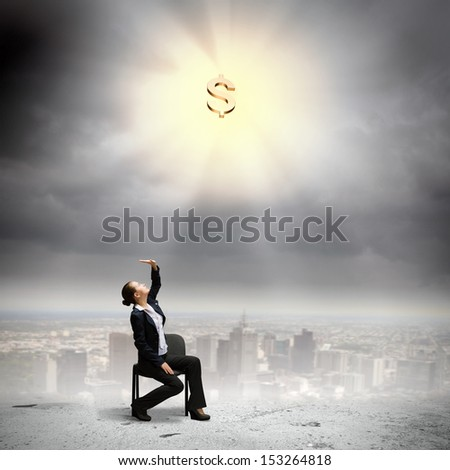 Image if businesswoman sitting on chair under rays of sun with dollar sign above