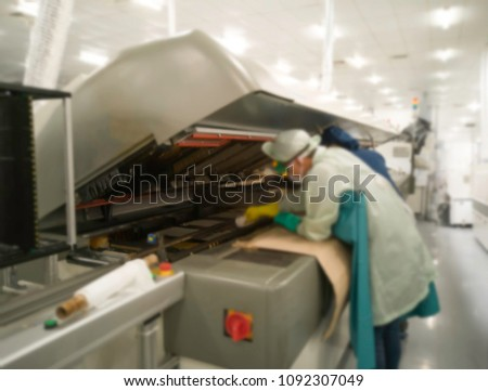 image not clear and blurred of maintenance technician open cover oven machine  weekly at maintenance at surface Mount Technology (SMT) for manufacturing of electronic equipment, blurred background