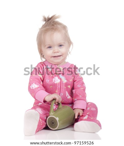 Image of a baby taking a coffee break.