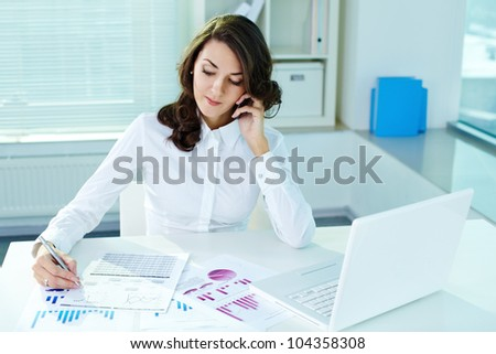 Image of a beautiful business lady in the middle of the workday