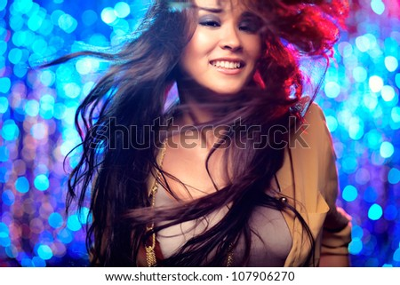 Image of a beautiful female dancer in motion