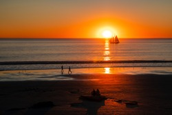 Image of a beautiful sunset on Cable Beach in Broome, Western Australia. Broome is a popular holiday destination in Australian winter.