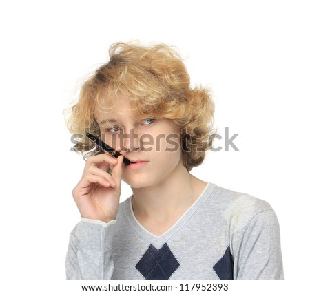 Image of a beautiful teenage boy holding  pen  and looking away