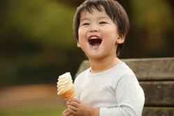 Image of a boy eating soft serve ice cream
