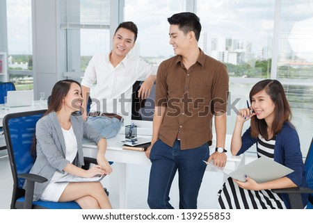 Image of a business command sharing new ideas at the office