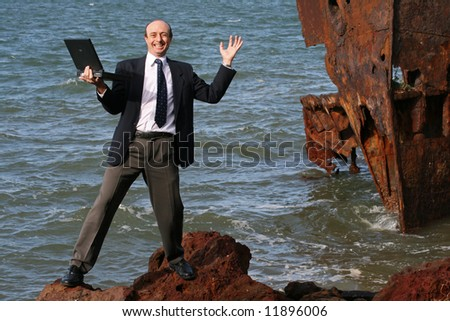 Image of a business man at a ship wreck