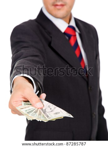 Image of a business man offering money, isolated on white