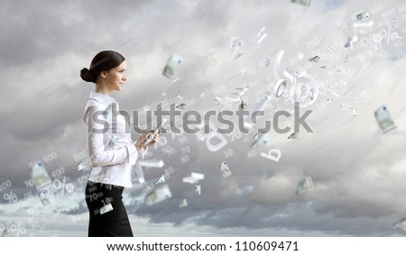Image of a business person and finance related background