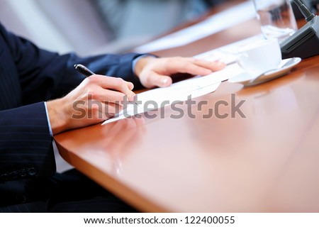 Image of a business work place with papers on the table
