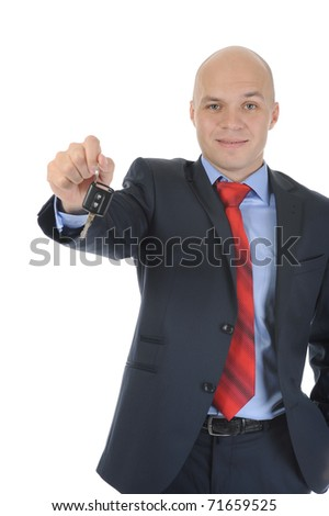 Image of a businessman gives the keys to the car. Isolated on white