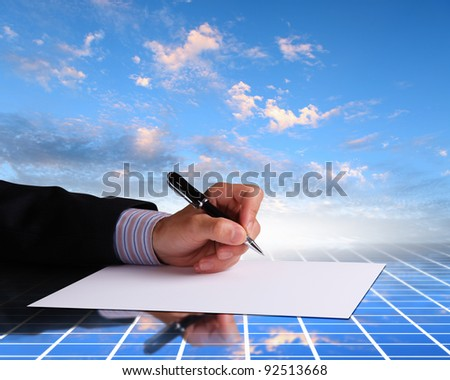 Image of a businessman hand signing documents