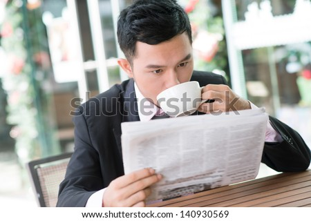 Image of a businessman having lunch outside