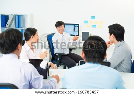 Image of a businessman presenting something at the seminar using tablet at the office on the foreground #160783457