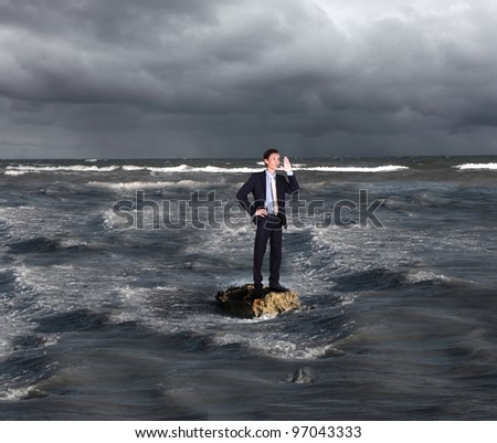 Image of a businessman surfing on the sea waves