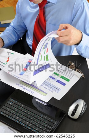 Image of a businessman working with documents in the office of the table #62545225