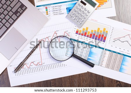 Image of a businessman workplace with papers