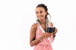 Image of a cheerful smiling young cute african woman with dreads posing isolated over white wall background drinking coffee or tea.