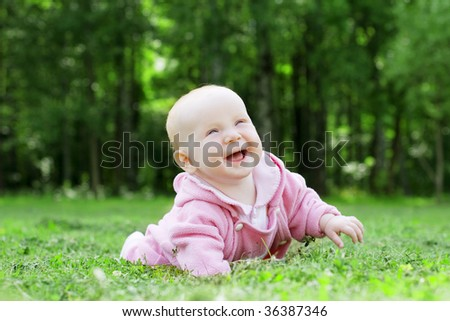 Image of a child lying on the grass in the park